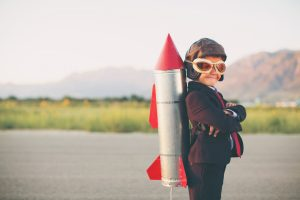 Boy with rocket moving forward with strategy