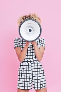 Women screaming through megaphone finding voice